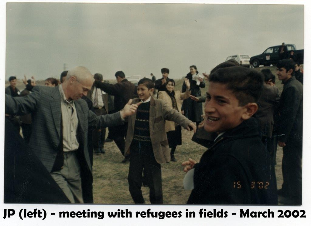 azerbaijan hockey MEETING FIELDS REFUGEES 2002